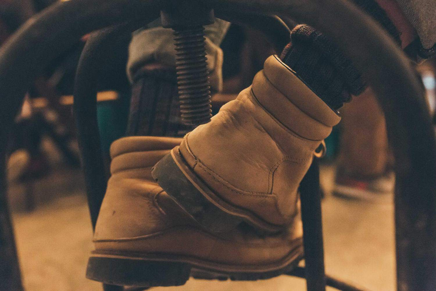 vegan timberlands person wearing boots while sitting on a chair